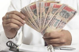 Rupee adds to losses, falls 10 paise to 66.93