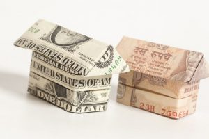 Rupee crosses 67-mark, slumps 52 paise against US Dollar