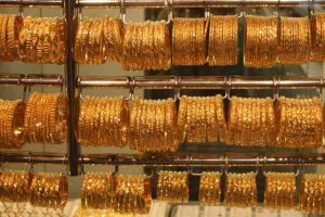 Gold slides on global cues, muted demand