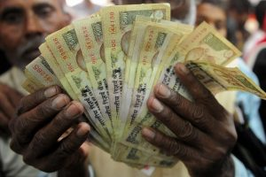 Frantic crowds cross border to unload Indian currency