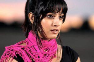 Varalaxmi dons khaki in Tamil remake of 'Kshanam'