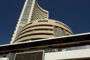 Stocks trade flat ahead of US Fed meet; Tata Motors shines