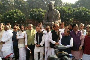 Opposition protests at Mahatma statue in Parliament complex