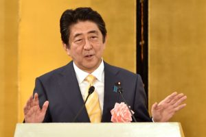 Shinzo Abe's ruling bloc bags two-thirds majority
