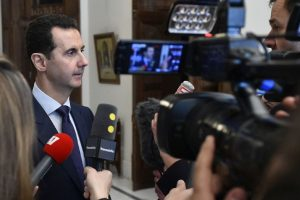 Syria government 'ready to negotiate on everything': Assad
