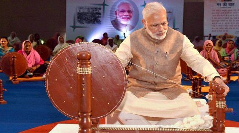 Online rage over Modi replacing Gandhi on charkha - The