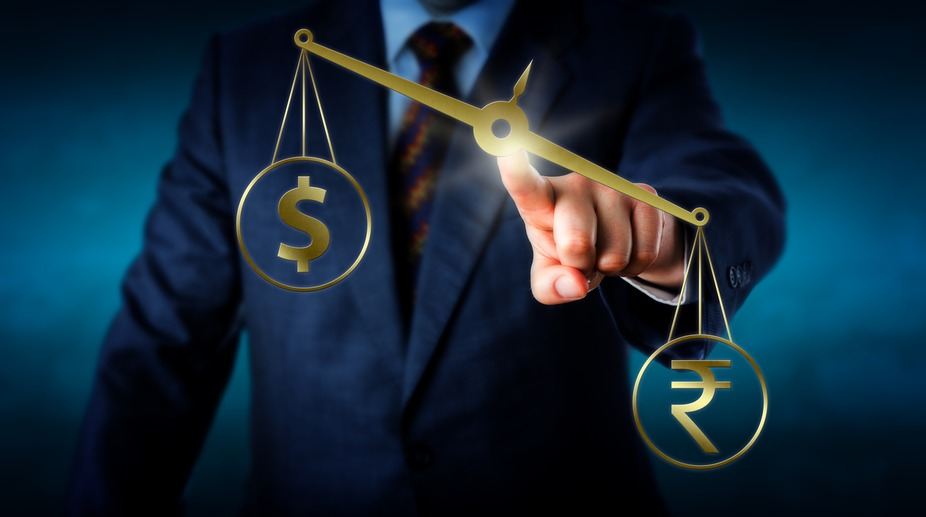 Rupee retreats from 2-1/2 year high; down 8 paise vs USD
