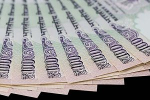 Rupee softens 14 paise against US Dollar