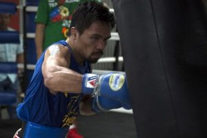 Manny Pacquiao to fight Britain's Amir Khan in April
