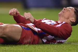 Atletico's Torres suffers 'traumatic brain injury'