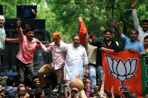 Celebrations break out at UP BJP office, silence at SP office