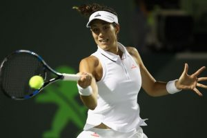 Miami Open: Rain saves struggling Muguruza as she trails McHale 0-6, 2-3