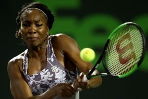 Venus, Kerber advance to third round at windy Miami Open
