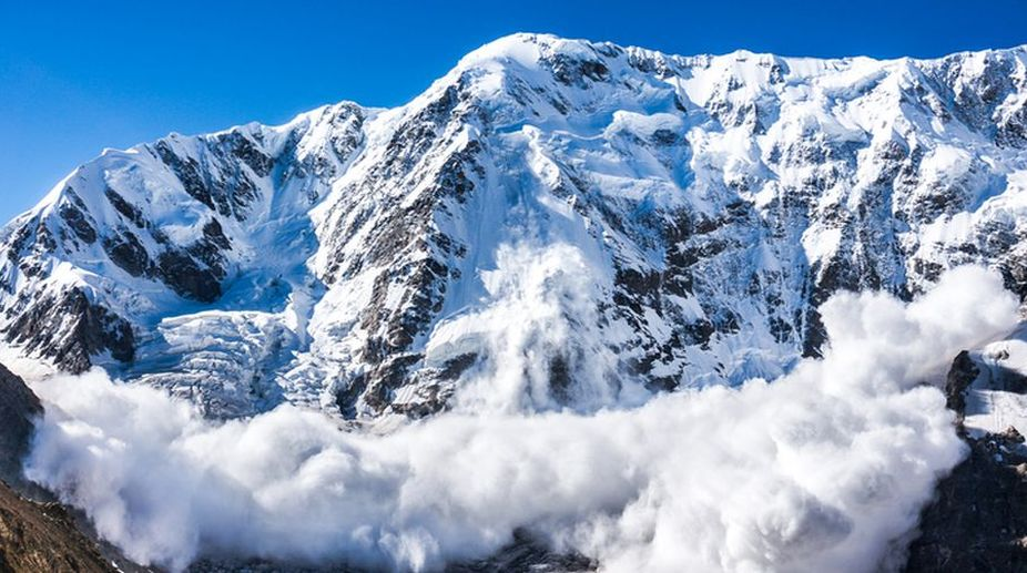 bodies recovered, avalanche site, Beacon officer, Five bodies