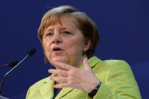 Angela Merkel makes rare Russia visit as Putin backs warmer ties