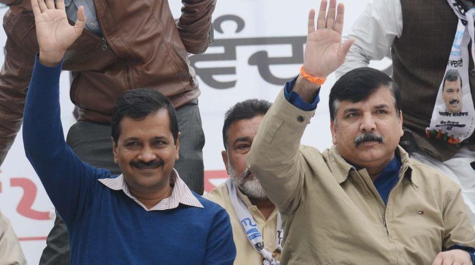 Delhi Chief Minister Arvind Kejriwal (L) and Sanjay Singh (R)