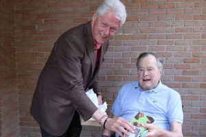 Bill Clinton meets George H W Bush, gifts socks