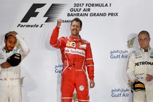 F1: Sebastian Vettel triumphs in Bahrain as Lewis Hamilton pays penalty