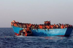 300 rescued migrants land in Italian island