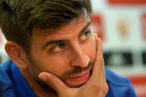 Gerard Pique keeps Barca unbeaten, Atletico cut gap