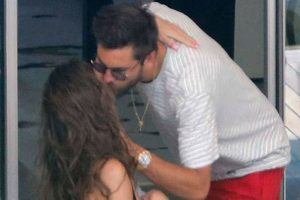 Scott Disick hangs out with topless woman