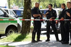 Munich shooting: Attacker shoots lady cop with her own gun