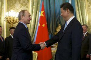 Putin and Xi talking N Korea, trade at Kremlin