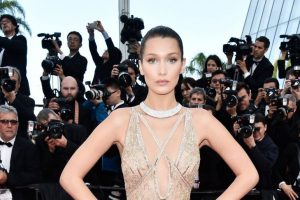 Bella Hadid gets new rose tattoo