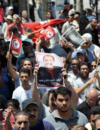 Tunisia faces strike threat after Opposition  leader's assasination