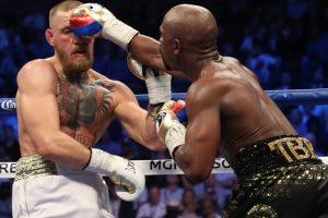 Invincible Floyd Mayweather TKOs Conor McGregor, ends career with 50-0 record