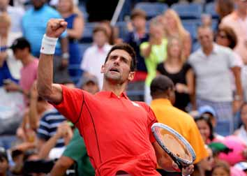 Djokovic, Murray in last eight