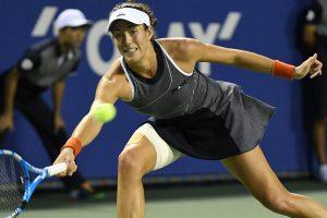 Garbine Muguruza stuffs Monica Puig to reach Tokyo quarters