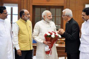 Rescued Kerala priest meets PM Modi, Swaraj