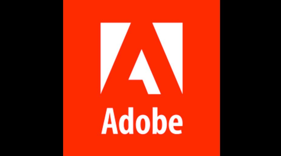 Adobe reports record $2 bn revenue in Q4