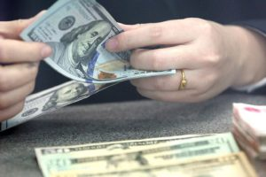 US dollar trades higher against major currencies after economic data