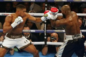 Boxing: Controversy as Anthony Joshua retains world heavyweight titles