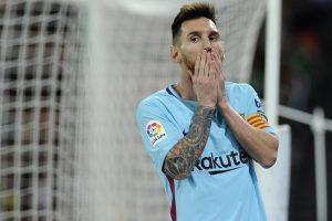 Messi maintains under-par Barcelona's lead over resurgent Valencia