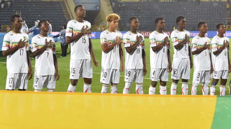 Members of Mali's soccer team stand for their national anthem before the start of their FIFA U-17 World Cup quarterfinal match