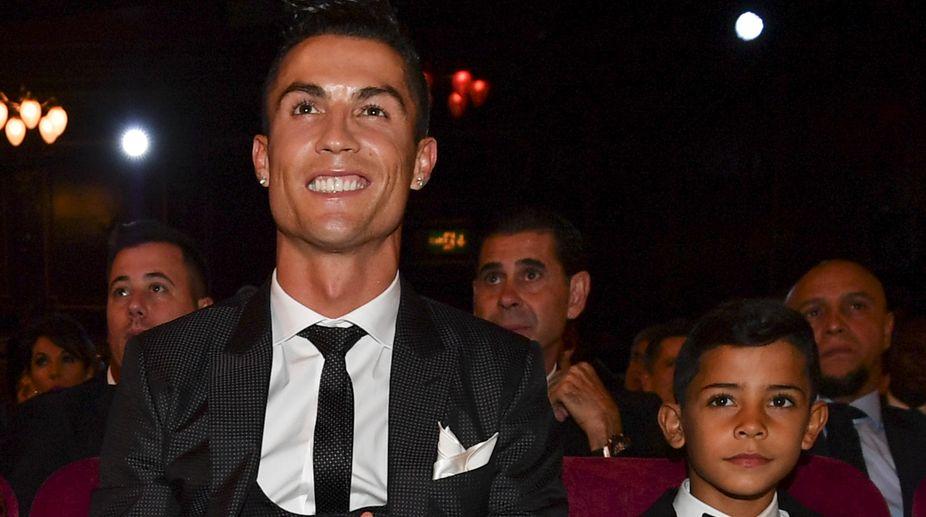 Cristiano Ronaldo Jr (L) with daddy Cristiano Ronaldo (Photo: AFP)