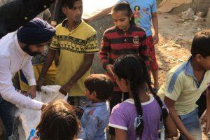 Delhi BJP leader distributes firecrackers to slum children