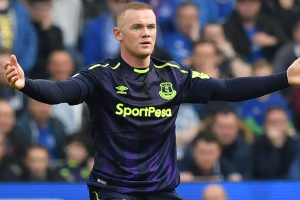 Premier League: Wayne Rooney penalty saves Everton's blushes at Brighton