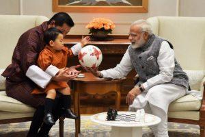 Modi gifts a football to Bhutan Prince