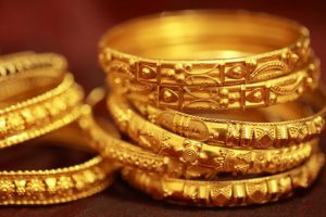 Gold weakens on global cues, muted demand