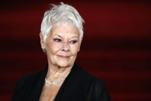 Judi Dench plants trees in memory of friends, family