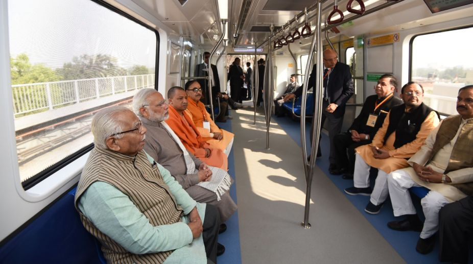 New Delhi: Prime Minister Narendra Modi takes a ride in Metro from Botanical Garden Station to Okhla Bird Sanctuary along with Uttar Pradesh Governor Ram Naik and Chief Minister Yogi Adityanath and other dignitaries after its inauguration at Noida, Uttar Pradesh on Dec 25, 2017. (Photo: IANS/PIB)