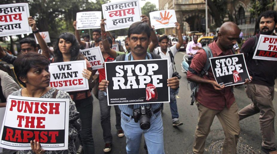 Indian police arrest 14 in rape, killing of lady