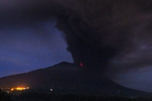 Bali volcano spews thick smoke and ashes