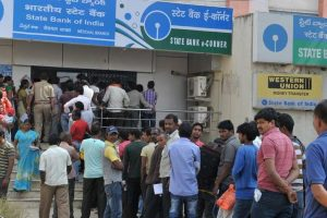 Cash crunch due to less income velocity, more withdrawals: SBI