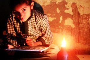 Siblings studying by candlelight sustain burns, 2 critical