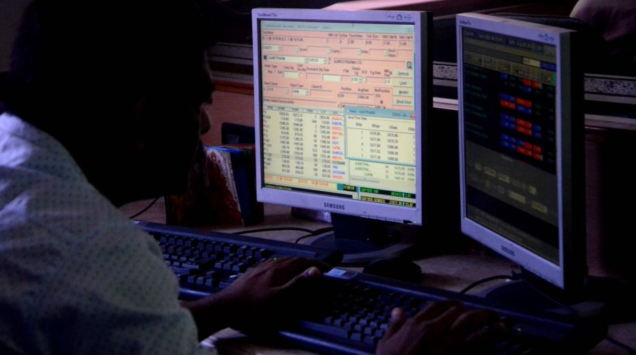Mumbai: A share-broker looking at the share prices in Mumbai (Photo: IANS)